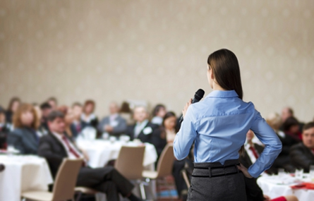 Photo of woman speaking at an organization
