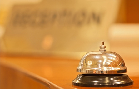 Photo of bell on hotel lobby desk