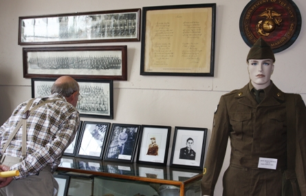 Photo of a man looking at military memorabilia in a museum